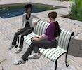 Two avatars chatting on a bench in EVA Park