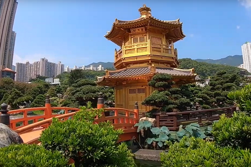 Photo of a temple, residential buildings and gardens in Hong Kong
